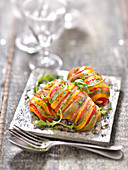 Turkey ballottines stuffed with mozzarella in a multicolored bell pepper dress
