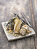 Pear ballottines with Saint-Morêt, honey and almonds in black sesame dress