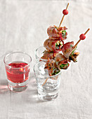 Snail and bacon brochettes