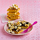 Waffles with chocolate and caramel popcorn