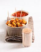 Patatas bravas with red chili pepper sauce
