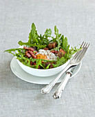 Dandelion,diced bacon and poached egg salad