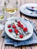 Sardines marinated in grape pip oil with fresh raspberries