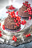 Mini double chocolate cakes with redcurrants
