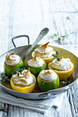 Lemons stuffed with citrus fruit cream and topped with meringue