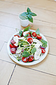 Thinly striped courgettes,sun-dried tomato,mozzarella,red onion and basil salad