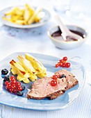 Boar Fillet With Red Berries And Parsnip Chips