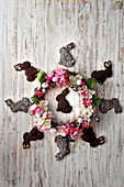 Crown Of Flowers And Chocolate Easter Rabbits