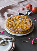 Rose and apple tart with almond cream and strawberry jam