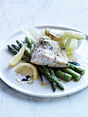 Roasted sea bass with kombu butter, iceberg lettuce and green asparagus