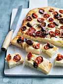 Unleavened bread with cherry tomatoes and rosemary