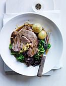 Stewed Lamb Shoulder with Lemon Zest, Cipollini Onions, Medjool Dates, Marcona Almonds and Lacinato Kale