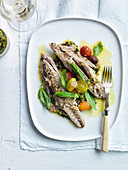 Mackerel with condiments, basil and multicolored cherry tomatoes