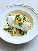 Poached snapper with chorizo oil and grilled corn salad