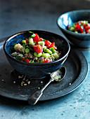 Quinoa, edamame, cucumber and tomato salad
