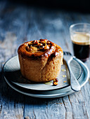 Cinnamon roll with apple and caramelized hazelnuts