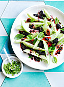 Galia melon salad with blackberries, basil leaves and sugar
