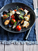Wood-fired mussels, tomatoes and toasted sourdough bread