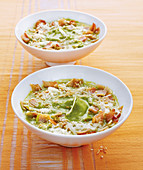 Crunchy zucchini soup with bacon, pine nuts and parmesan