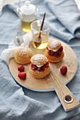 Cream puff with fresh raspberries