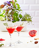 Cocktail, pomegranate juice, thyme and cardamom cocktail