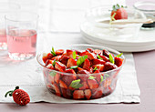 Strawberry fruit salad with fresh basil