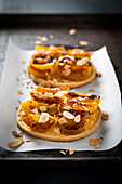 Roasted apricot and thinly sliced almond tartlets