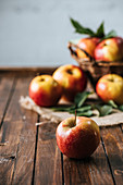 selective focus of fresh apples on dark wooden surface