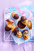 Chocolate covered madeleine lollipops
