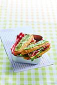 Raw ham, Emmental and confit tomato Eclair sandwich