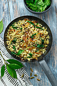 Rice fried with lentils and spinach