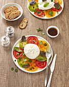 Burrata with tomatoes and three types of basil