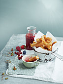 Churros with red fruit coulis