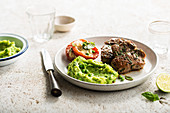 Grilled Lamb with Mint Pea Puree and Parmesan Tomato