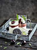 Vanilla mousse trifle with cherry and cocoa tuile