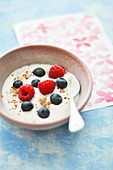 Bowl Of Fromage Blanc With Summer Berries And Crushed Almonds