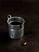 Small metal jug of melted chocolate