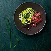 Zucchini spaghetti with diced raw tuna