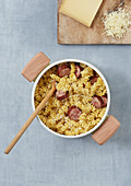 Fusilli with sausage and grated Comté cheese