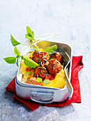 Meatballs in tomato sauce with polenta