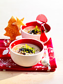 Christmas mushroom soup with thinly sliced truffles