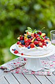 Summer fruit Pavlova outdoors