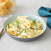 Pasta with cheese and rocket lettuce