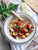 Orecchiette with confit tomatoes and basil