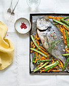 Baked sea bream with spring vegetables