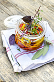 Marinated peppers with herbs and purple shiso