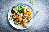 Steamed salmon steak with leeks and sauteed potatoes