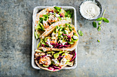 Salmon tacos and red cabbage