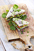 SandwIch with watercress, avocado, salmon and tomatoes