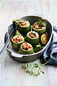 Zucchini stuffed with rice, tomato and olives